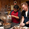 Baan Sawan Chef Alex Suaudom du Monde and Motor Supply sous chef Matt Harvell prepare the main course for a Nose to Tail dinner at City Roots on March 11, 2013.