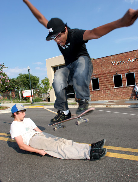 Roberto Perozo, 18, of Irmo, ollies over Columbia resident Michael Garner, 14, in front of Gallery 80808 on Lady St.