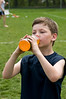 Ryan Ullman, a second grader at Cold Springs ES, needs some liquid refreshment on a very hot day.
