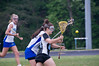 Emily Patch of Whitman has the ball knocked out of her stick.
