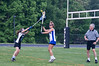 Angela Bicoicchi of Churchill just gets her pass off before the Whitman player can knock the ball out of her stick.