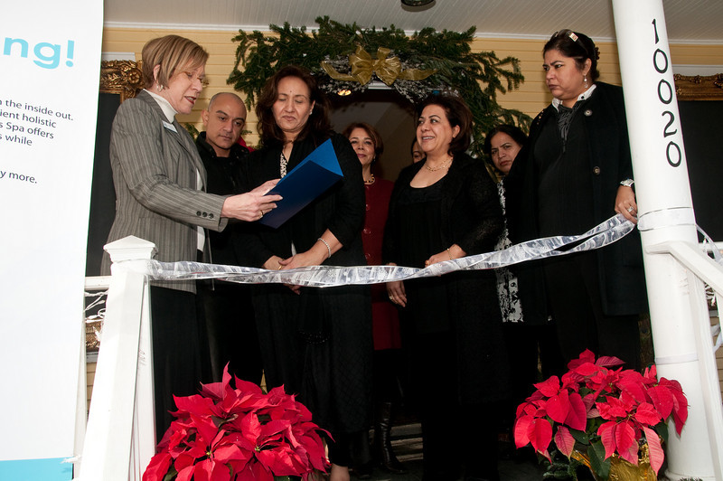 Char Rosnick (Congressman Chris Van Hollen's representative) presents Rosie Ahmad (Amani owner) with a certificate from Congressman Van Hollen commerating the opening of the Amani Wellness Spa.