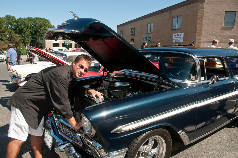 Steven Ornstein, owner of Plant's Etc. in downtown Potomac, shows his 1956 Chevy Nomad.