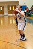 Ashley Nelson attempts a 3 point shot.