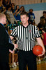 Matt Miller, Churchill coach, argues with official that the shot at the buzzer ending the first half should count.