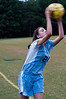 Whitman Sr. Kat Barth throws the ball in.