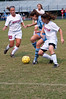 Whitman Sr. Kat Barth and Wootton Jr .Liz Inserra go battle for the ball. Wootton Jr. Jessica Welsh enters the fray.