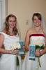 Sophie Minaert (left) and Elizabeth Krause model inexpensive wedding gowns offered by St. Anthony's Bridal.