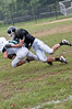 Safety Chris Caylor tackles the ball carrier.