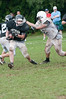 Running back Leo Doran evades a tackler.