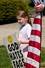 """A message of hate along with the American flag as the Westboro (KS) Baptist Church protests at Walt Whitman HS because it was named after a """"fag""""."""
