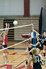 Samantha Riemer (#15) of Whitman knocks the bal over the net.  Ellie Fitzgerald of Wootton defends.