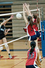 Katie McKenna and Abby Hsiung of Wootton jump to block the shot.