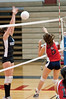 Katie McKenna of Wootton knocks the ball over the net. Vera Ivezic defends for Whitman.