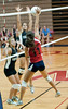 Abby Hsiung of Wootton tries to get the ball past the  hands of Priscllia North of Whitman.