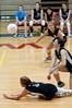 Hidemi Omori of Whitman dives for the ball.