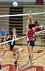 Janet Hu of Wootton (#10) and teammate Allison Wynant  knock the ball accross the net.