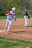 #10 rounds third base on the way to scoring.