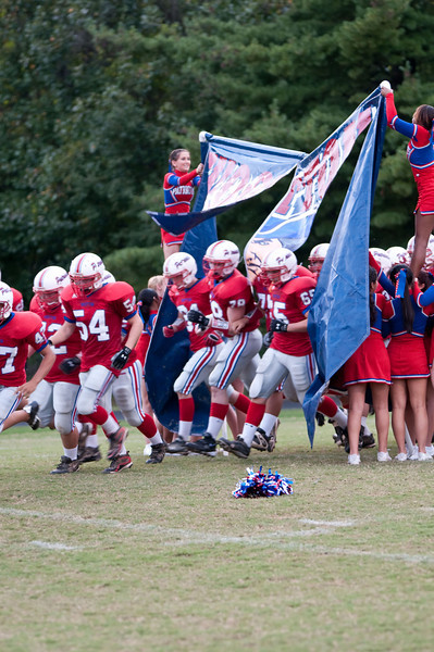 Wootton players run onto the field.