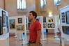 Adam Bogucki of Bethesda looks over the paintings for sale at the annual Arts Show at Glen Echo.