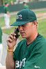 Joe Mantiply, starting pitcher, takes a phone call from a friend wishing him well prior to the start of the action.