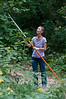 Valerie Yaplee uses the pole saw to remove hard to reach overhanging branches.