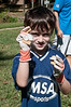 Omer Tzioni of Potomac (6 1/2 years old) holds up some of the debris he picked up and is about to throw into a trashbag.