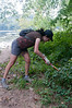 Terri Strassburger cuts back overgrown areas near the bank of the Potomac.