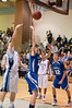 Jordan Bass of Churchill puts up a layup.