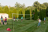 Kids play volleyball.
