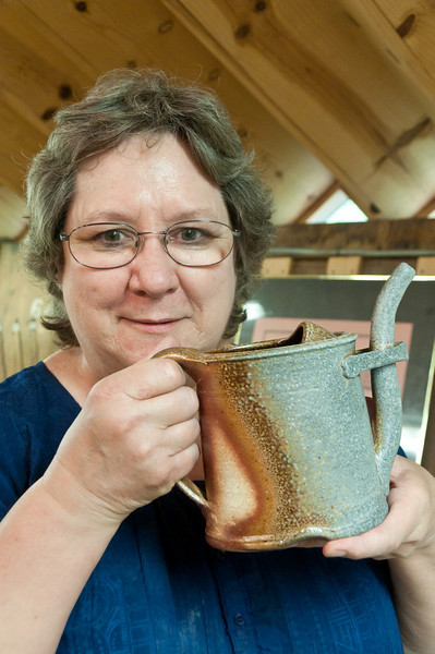 Kathy Darby, an instuctor at Glen Echo Pottery, with her wood-fired watering can