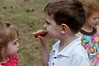 Samantha Kelly watches her brother Jacob Kelly eat a hot dog.
