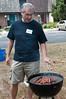 The head chef, Evan Foster, cooks hot dogs.