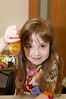 """Kay Lee Fellner, 6 years old, shows off the """"chanukah gelt"""" she received."""