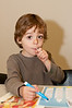 Three year old Tobias Subiela does some coloring while waiting for the event to start.