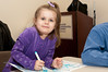 Three year old Elizabeth Seldin is exuberant about her coloring.