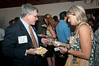 Frank Cardy (Case Design) and Debbie Ciardo (Hopkins Porter) exchange business cards.