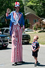 A tall Uncle Sam and 6 year old Ryan Caudron