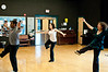 Choreographer Melanie Barber (front) teaches a dance sequence to Mallory Shear and Tricia Weiler.