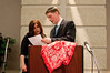 Jessica Eizenstat,who is in charge of the Torah School of Greater Washington's 7th Annual Chinese Auction, along with auctioneer Yoni Tyberg, go over the prize list before the auction begins.