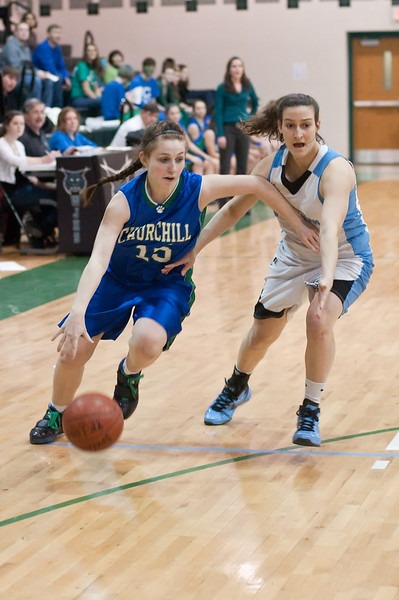 Ashley Nelson of Churchill tries to dribbles past Caroline Kahlenberg of Whitman.