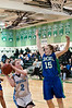 Emily Savage of Whitman looks to shoot over Ashley Nelson of Churchill