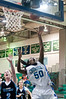 Serafina Authur-Williams of Churchill shoots from underneath the basket.