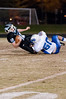 Henry Kuhn, Whitman QB is tackled in the backfield by Bret Sickels of Churchill.