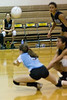 #9 Emily Sartain dives to save the ball.