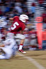 Josh Meltzer, Wootton QB, tries to shake of a tackler as he approaches a first down.