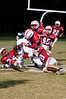 Rico Djidotor, Whitman WR, is tackled deep in Wootton territory by a host of defensemen.