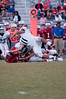 Wootton running back Harrison Bridge is brought down by Whitman's Tony Atkinson (#11)