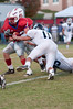 Harrison Bridge of Wootton is tackled by Ned Daryoush (#75 bottom) and Tony Atkinson (#11)