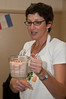 Debbie Sokobin demonstrates how much the proofed yeast mixture rose.